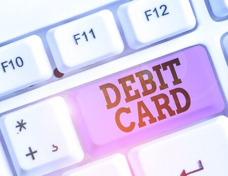 Writing note showing Debit Card. Business concept for card that deducts money directly from a demonstrating s is checking account Stok Fotoğraf
