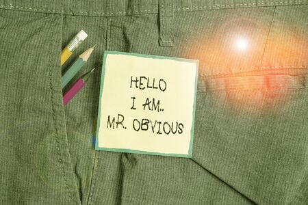 Text sign showing Hello I Am Mrobvious. Business photo showcasing introducing yourself as pouplar or famous demonstrating Writing equipment and green note paper inside pocket of man work trousers