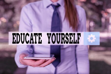 Conceptual hand writing showing Educate Yourself. Concept meaning prepare oneself or someone in a particular area or subject Business woman in shirt holding laptop and mobile phone