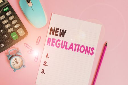 Word writing text New Regulations Question. Business photo showcasing rules made government order control way something is done Calculator clips alarm clock mouse sheet pencil colored background Stock Photo