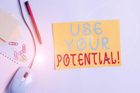 Word writing text Use Your Potential. Business photo showcasing achieve as much natural ability makes possible Cardboard and writing equipment with modern gadget above pastel backdrop