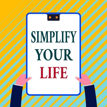 Writing note showing Simplify Your Life. Business concept for Manage your day work Take the easy way Organize White rectangle clipboard with blue frame has two holes holds by hands