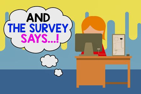 Text sign showing And The Survey Says. Business photo showcasing written spoken results of short quiz or exam on internet Young female working office sitting desktop computer office monitor photo
