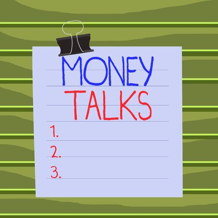 Conceptual hand writing showing Money Talks. Concept meaning the wealth gives power and influence to those who possess it Paper lines binder clip suare notebook color background