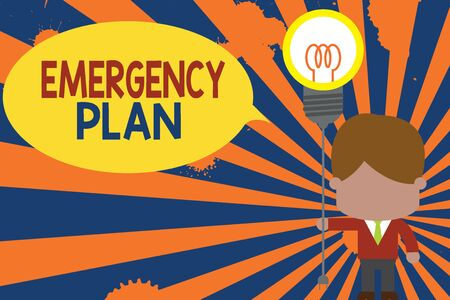 Conceptual hand writing showing Emergency Plan. Concept meaning procedures for handling sudden or unexpected situations Standing man tie holding plug socket light bulb Idea Startup 写真素材