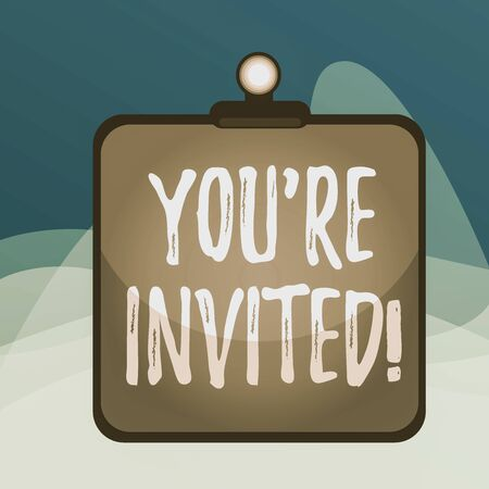 Writing note showing You Re Invited. Business concept for make a polite friendly request to someone go somewhere Clipboard colorful background spring clip stuck bind empty plank frame