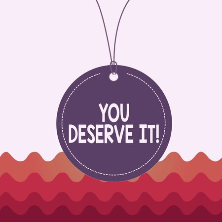 Conceptual hand writing showing You Deserve It. Concept meaning should have it because of their qualities or actions Label string round empty tag colorful background small shape Stock fotó