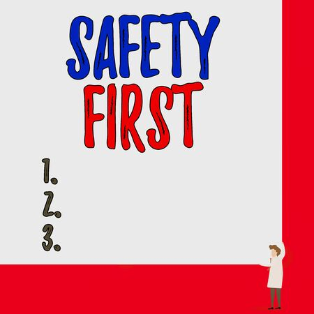 Text sign showing Safety First. Business photo showcasing used to say that the most important thing is to be safe One man professor wear white coat red tie hold big board use two hands