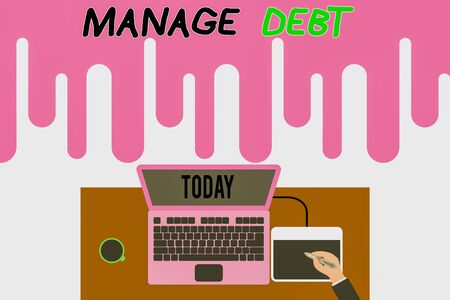 Handwriting text writing Manage Debt. Conceptual photo unofficial agreement with unsecured creditors for repayment Upper view laptop wooden desk worker drawing tablet coffee cup office 스톡 콘텐츠