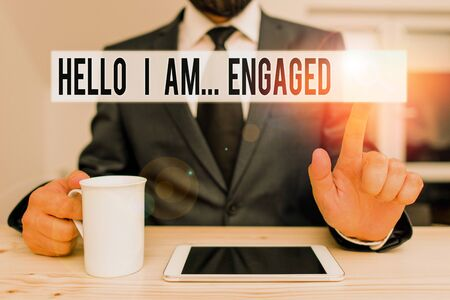 Text sign showing Hello I Am Engaged. Business photo showcasing He gave the ring We are going to get married Wedding Male human wear formal clothes present presentation use hi tech smartphone