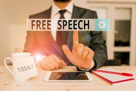 Text sign showing Free Speech. Business photo text the right of showing to express their opinions publicly Male human wear formal clothes present presentation use hi tech smartphone