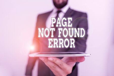Word writing text Page Not Found Error. Business photo showcasing message appears when search for website doesnt exist Male human wear formal work suit hold smart hi tech smartphone use one hand
