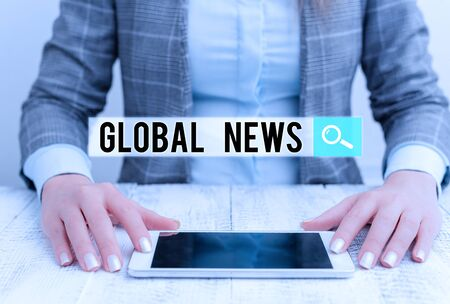 Handwriting text Global News. Conceptual photo world noteworthy information about recent or important events Business woman sitting with mobile phone on the table