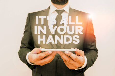 Text sign showing It S All In Your Hands. Business photo text we Hold the Rein of our Destiny and Fate Male human wear formal work suit hold smart hi tech smartphone use hands