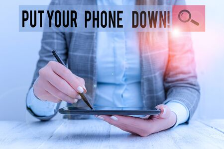 Writing note showing Put Your Phone Down. Business concept for end telephone connection saying goodbye caller Business woman sitting with mobile phone and pen in the hand