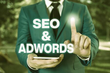 Conceptual hand writing showing Seo And Adwords. Concept meaning Pay per click Digital marketing Businessman with pointing finger in front of him