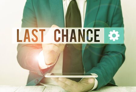 Writing note showing Last Chance. Business concept for a situation considered to be the last opportunity for success Businessman pointing with pen in empty copy space Stock Photo - 134417369