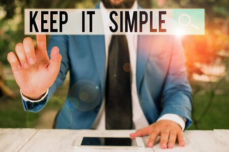 Conceptual hand writing showing Keep It Simple. Concept meaning Easy to toss around Understandable Generic terminology Businessman with pointing finger in front of him
