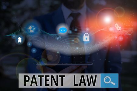 Writing note showing Patent Law. Business concept for deals with an inventor s is exclusive right to use own invention