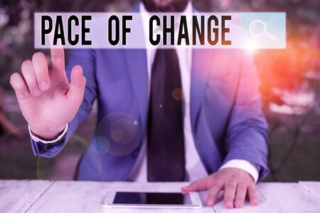 Conceptual hand writing showing Pace Of Change. Concept meaning Shift in normal routine Variation in usual activities Businessman with pointing finger in front of him