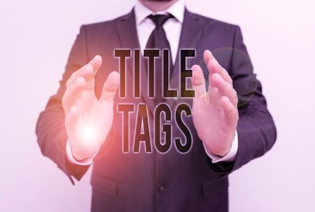 Writing note showing Title Tags. Business concept for the HTML element that specifies the title of a web page Male human with beard wear formal working suit clothes hand