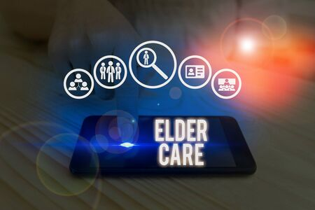 Writing note showing Elder Care. Business concept for the care of older showing who need help with medical problems 版權商用圖片