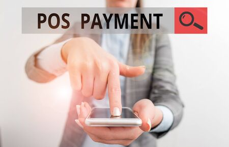 Writing note showing Pos Payment. Business concept for customer tenders payment in exchange for goods and services Business woman points with finger on touch screen
