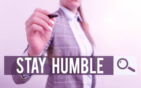 Handwriting text writing Stay Humble. Conceptual photo not proud or arrogant Modest to be humble although successful Business woman pointing in empty space with pen