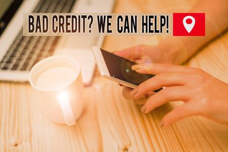 Word writing text Bad Credit Question We Can Help. Business photo showcasing offering help after going for loan then rejected woman laptop computer smartphone mug office supplies technological devices