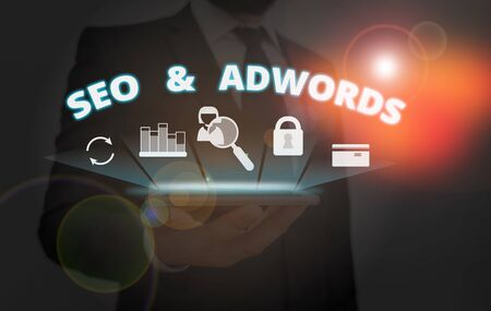 Writing note showing Seo And Adwords. Business concept for Pay per click Digital marketing Google Adsense