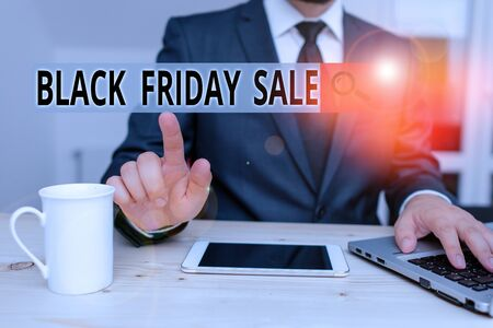 Handwriting text Black Friday Sale. Conceptual photo Shopping Day Start of the Christmas Shopping Season Male human wear formal clothes present presentation use hi tech smartphone