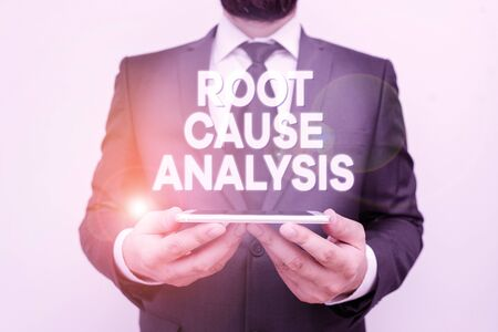 Text sign showing Root Cause Analysis. Business photo text Method of Problem Solving Identify Fault or Problem Male human wear formal work suit hold smart hi tech smartphone use hands Stock Photo