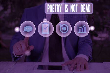 Text sign showing Poetry Is Not Dead. Business photo showcasing aesthetic and rhythmic writing is still alive and modern