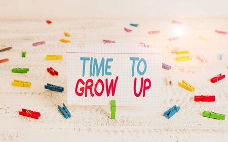 Handwriting text writing Time To Grow Up. Conceptual photo knowing that you are mature demonstrating have responsibility Green clothespin white wood background colored paper reminder office supply Stockfoto
