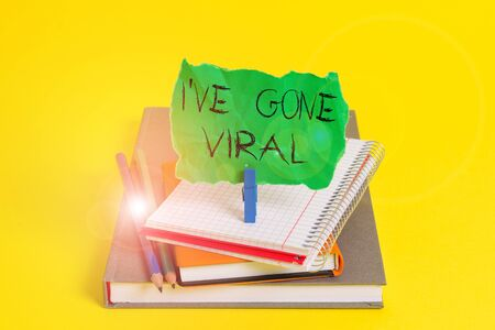 Text sign showing I Ve Gone Viral. Business photo showcasing medical term used to describe small infectious agent Book pencil rectangle shaped reminder notebook clothespin office supplies 版權商用圖片