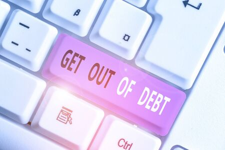 Writing note showing Get Out Of Debt. Business concept for No prospect of being paid any more and free from debt Archivio Fotografico