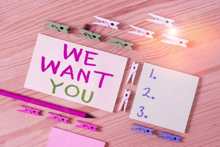 Text sign showing We Want You. Business photo showcasing Company wants to hire Vacancy Looking for talents Job employment Colored clothespin papers empty reminder wooden floor background office Banque d'images