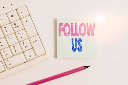 Handwriting text Follow Us. Conceptual photo To invite a demonstrating or group to join his company and take rules White pc keyboard with empty note paper and pencil above white background Stockfoto