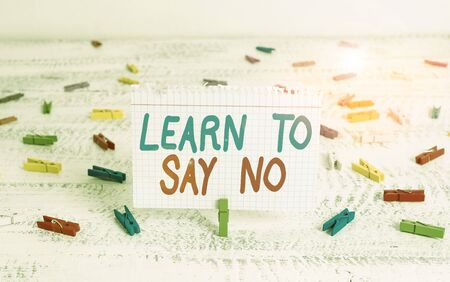Handwriting text writing Learn To Say No. Conceptual photo dont hesitate tell that you dont or want doing something Green clothespin white wood background colored paper reminder office supply