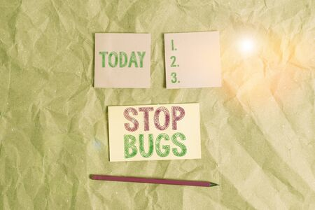 Handwriting text Stop Bugs. Conceptual photo Get rid an insect or similar small creature that sucks blood Papercraft craft paper desk square spiral notebook office study supplies Archivio Fotografico