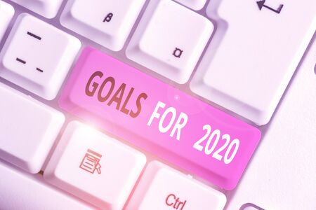 Writing note showing Goals For 2020. Business concept for The following things you want to have and achieve in 2020