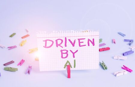 Word writing text Driven By A1. Business photo showcasing Move or controlled by a top quality driver in the society Colored clothespin rectangle square shaped paper light blue background 스톡 콘텐츠