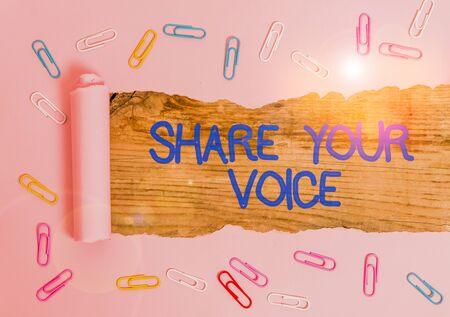 Handwriting text Share Your Voice. Conceptual photo asking employee or member to give his opinion or suggestion Paper clip and torn cardboard placed above a wooden classic table backdrop