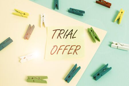 Word writing text Trial Offer. Business photo showcasing A temporary free or discounted offer of a product or services Colored clothespin paper empty reminder yellow blue floor background office