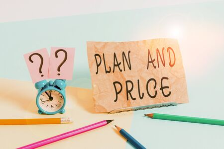 Conceptual hand writing showing Plan And Price. Concept meaning setting decent price for product to sale according market Mini size alarm clock beside stationary on pastel backdrop 免版税图像
