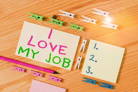 Text sign showing I Love My Job. Business photo showcasing Enjoying the daily tasked assigned Contented on the occupation Colored clothespin papers empty reminder wooden floor background office Stock fotó