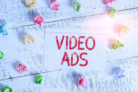 Handwriting text writing Video Ads. Conceptual photo Engage audience in the form of video content advertising Crumpled colored rectangle square shaped paper reminder white wood desk