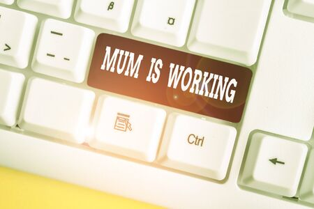 Word writing text Mum Is Working. Business photo showcasing Financial Empowerment and professional progressing mother White pc keyboard with empty note paper above white background key copy space 写真素材