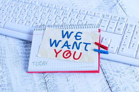 Conceptual hand writing showing We Want You. Concept meaning Company wants to hire Vacancy Looking for talents Job employment notebook reminder clothespin with pinned sheet light wooden