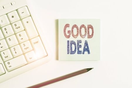 Handwriting text Good Idea. Conceptual photo an excellent suggestion and plan for achieving something White pc keyboard with empty note paper and pencil above white background